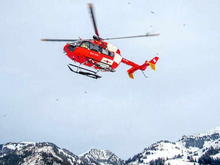 Rega Eurocopter Snow Nature Winter Cold Temperature Sky Day No People Red Flying Mountain Air Vehicle Helicopter