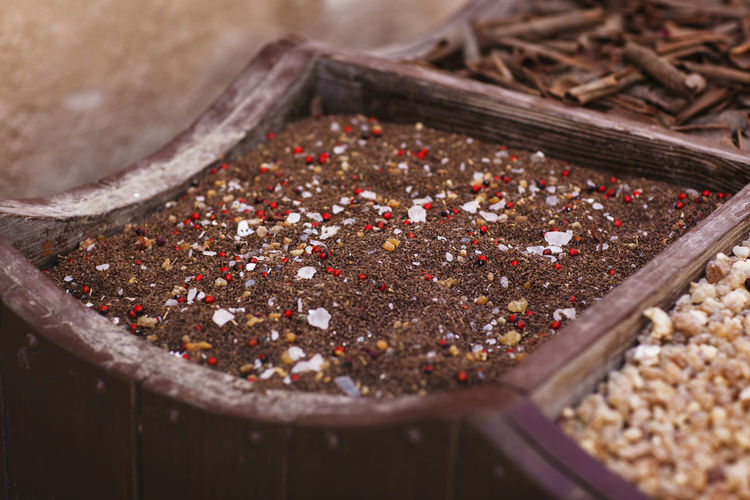 Large selection of different spices on the market, close-up