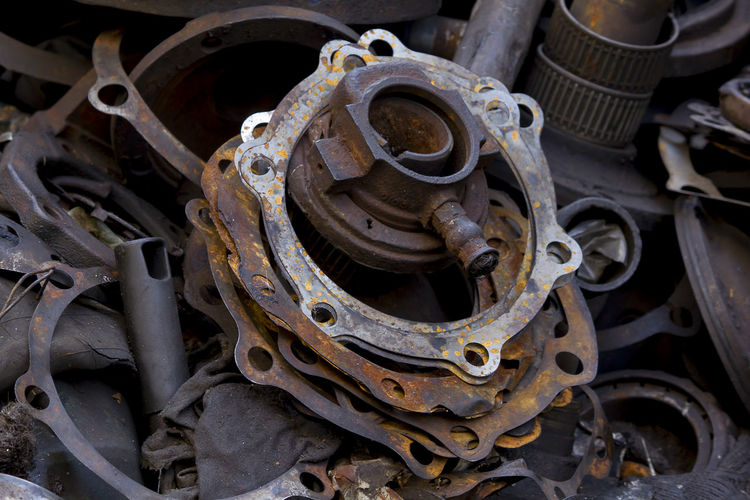 Old gaskets on lots of piles of material. Old Gaskets Abandoned Close-up Complexity Damaged Day Decline Deterioration Equipment Gaskets Changed Gear Industry Iron - Metal Junkyard Land Vehicle Machine Part Machinery Metal Mode Of Transportation No People Obsolete Run-down Rusty Transportation Wheel