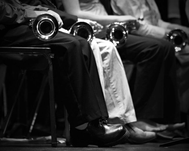 Arts Band Black Black And White Chairs Clothing Concert Culture Entertainment Getty Images Indoors  Inside Legs Lifestyle Music Orchestra People Person Instruments Row Shoes Sitting Trumpet Trumpets White