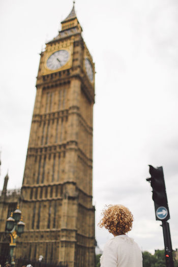 Architecture Big Ben Big Ben Blonde Building Exterior Built Structure Capital Cities  Clear Sky Clock Tower Curly Hair People And Places Girl History International Landmark Low Angle View Outdoors Sky Tall Tall - High Tourism Tower Travel Travel Destinations London Lifestyle EyeEm LOST IN London Your Ticket To Europe Been There. Postcode Postcards