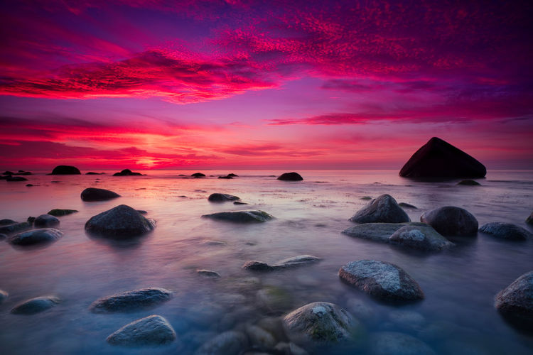 Schwanenstein at Rügen, Germany Sky Sea Water Sunset Beauty In Nature Cloud - Sky Scenics - Nature Rock Tranquility Solid Horizon Horizon Over Water Tranquil Scene Rock - Object Idyllic Long Exposure No People Motion Land Outdoors Purple Romantic Sky Schwanenstein Rügen Germany