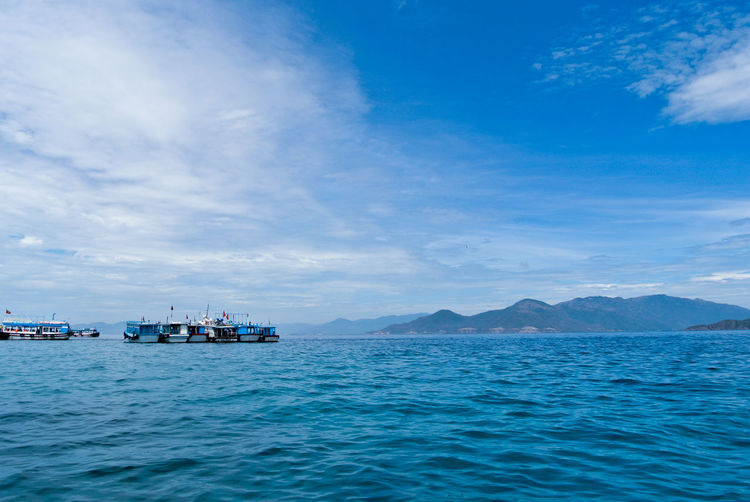 a morning on the sea Blue Boat Cloud - Sky Clouds And Sky Day Mountain No People Outdoors Scenics Sea Sky Tranquil Scene Tranquility Transportation Water EyeEmNewHere