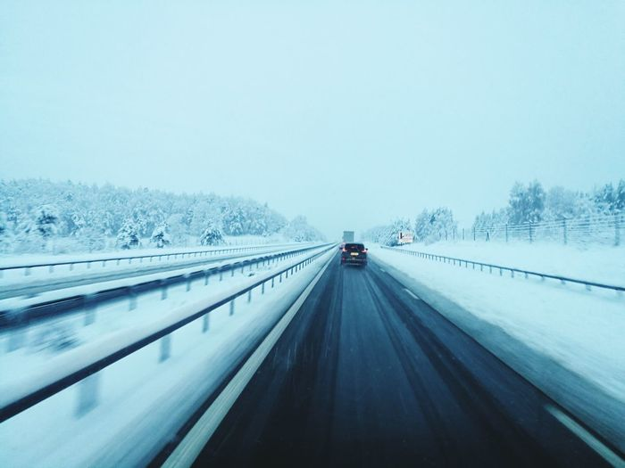 Cold Temperature Snow Winter Weather Transportation Snowing Mode Of Transport Driving Highway Tire Track Road Tree Outdoors Nature No People Day