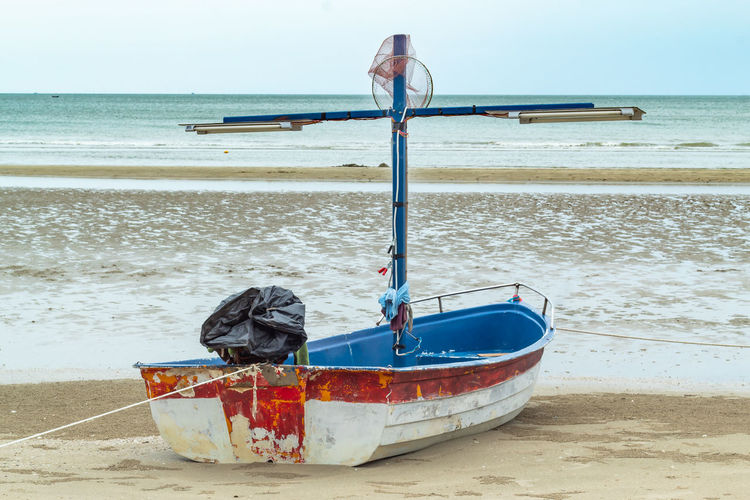 Beach Beauty In Nature Day Horizon Horizon Over Water Land Mode Of Transportation Moored Nature Nautical Vessel No People Outdoors Rowboat Sand Scenics - Nature Sea Sky Tranquil Scene Tranquility Transportation Water