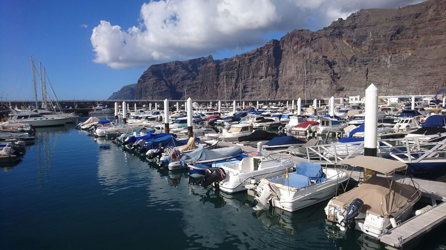 Los Gigantes. Tenerife Los Gigantes SPAIN España Canary Islands Islas Canarias Boats Marina Harbor Port Sailboat Sailing Beautiful Day White And Blue Water Nautical Vessel Sea Beach Mountain Sand Summer Harbor Sky Cloud - Sky