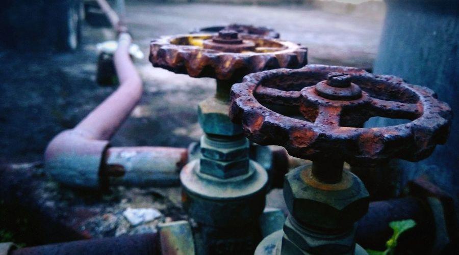 Close-up of rusty machine valves