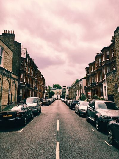 Street scene of empty road, London. Architecture Building Exterior Built Structure Car City Day Land Vehicle Mode Of Transport No People Outdoors Road Sky Storm Storm Clouds Street Transportation