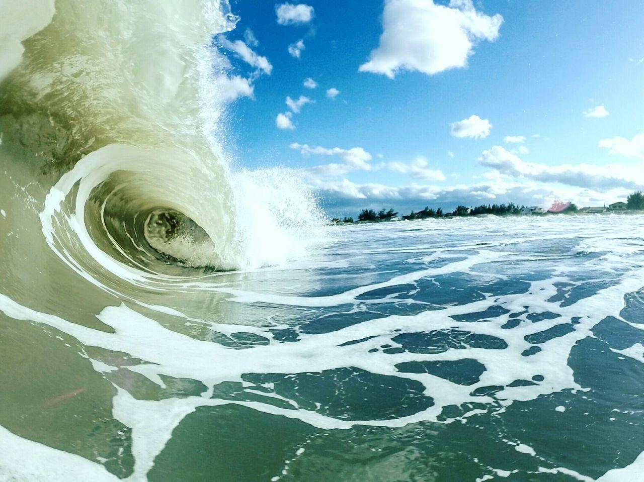 Sea Waves Flowing Against Sky