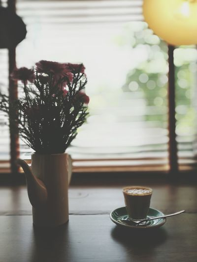 Pink Flowers And Coffee Cup Indoors