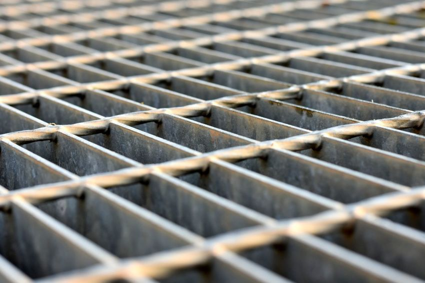 iron grate over drainage way Backgrounds Close-up Day Drainage Way Iron Grate No People Pattern Repetition Selective Focus