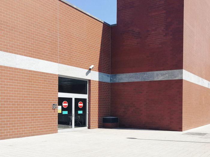 Mall Signal Forbidden Façade Architecture Building Exterior Built Structure Entryway Door Handle Closed Door Entry Brick Wall Door Brick