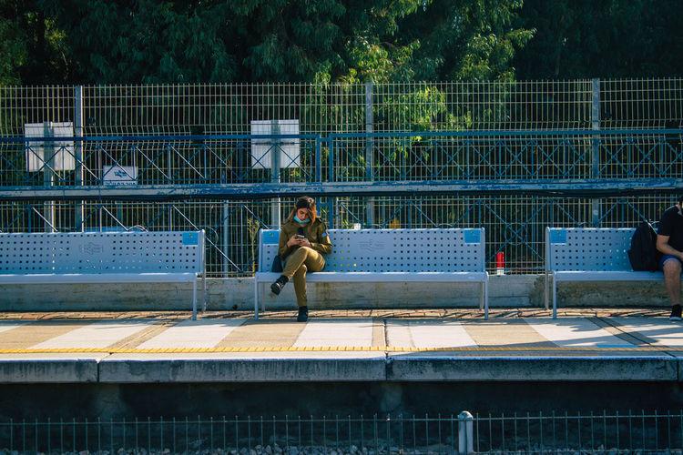 Man playing soccer on railing