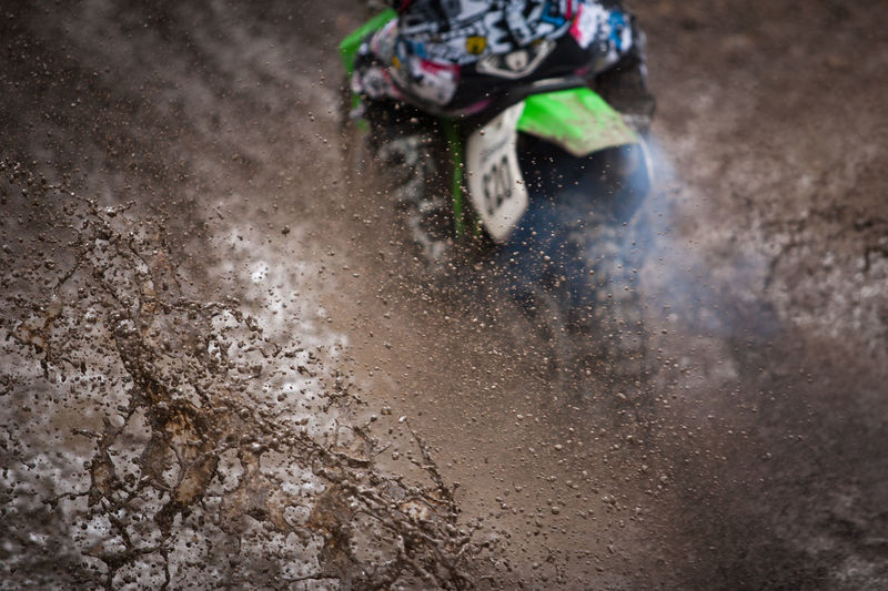 High Angle View Of Motocross Rider Splashing Mud