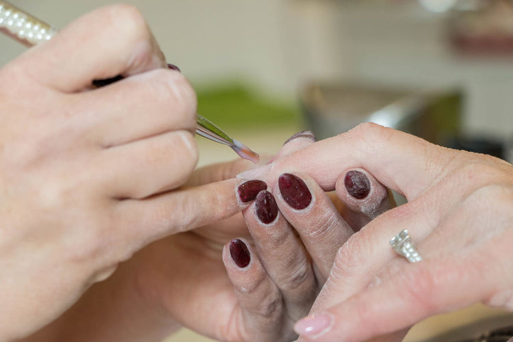 Close-Up Of Hand Giving Manicure Of Customer