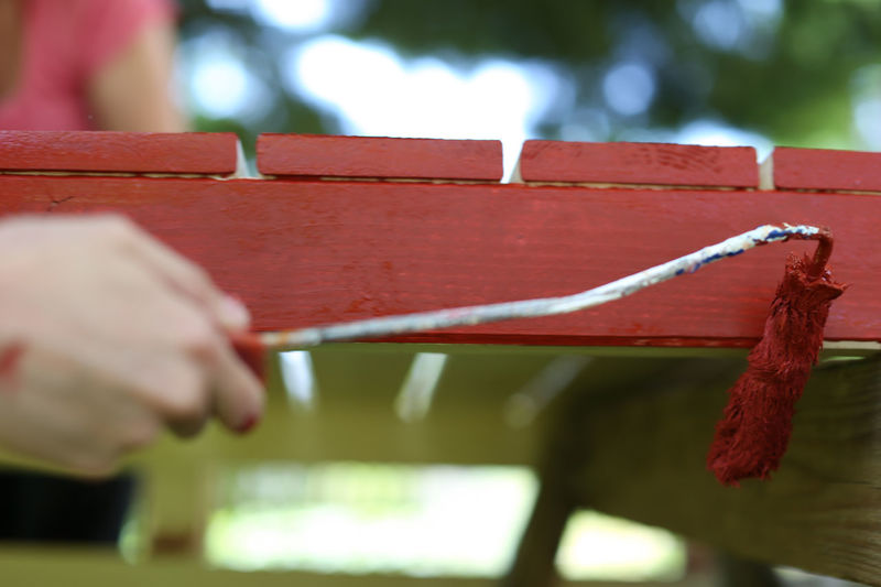 A wooden board is colored in red Close-up Color Color Roller Pensil Pint Red Red Color Renovating Renovation Renovations Renovierung Roller Rot Streichen Work