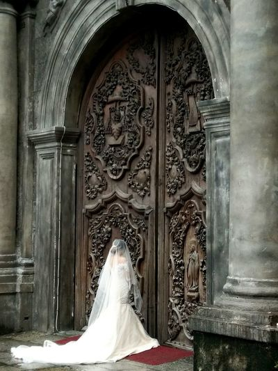 The bride and a 400yrs old church in the Philippines. San agustin church in manila. Bride Bridetobe Bride Dress Bride Photography Doorway Church Architecture Church Sculpture Wedding Wedding Day Wedding Photography Wedding Dress