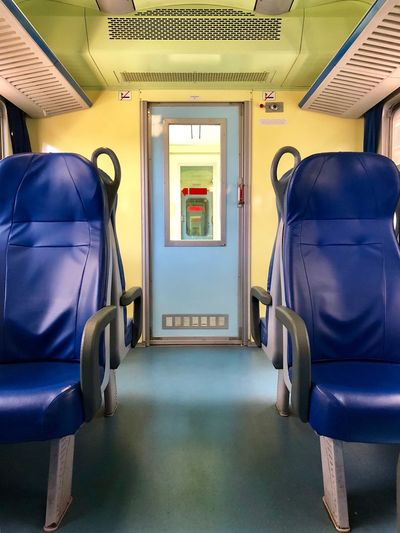 Train Vehicle Interior Transportation Mode Of Transportation Indoors  Vehicle Seat Travel Seat No People Passenger Train Train - Vehicle Absence Public Transportation Train Empty Rail Transportation The Way Forward Blue