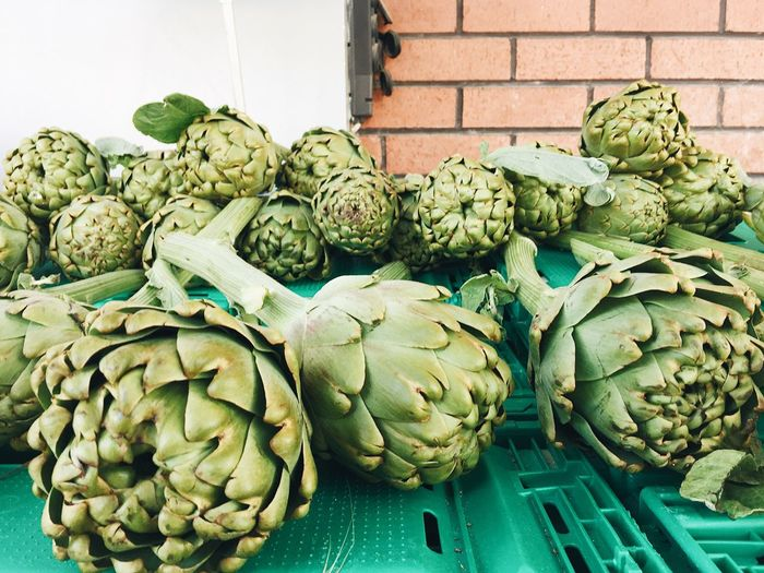 Close-up of artichokes for sale at market stall