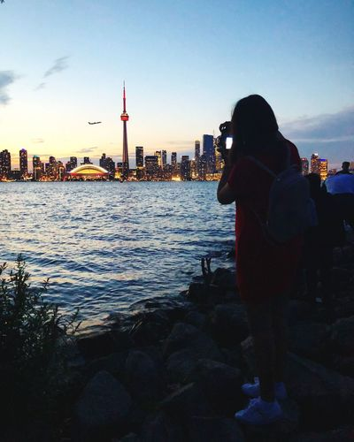 Capturing views from the 6ix 📸 Views The 6ix Happy Photography Portrait Toronto Sky Water Building Exterior Architecture Built Structure City Real People Nature Lifestyles City Life Silhouette Outdoors Cityscape Sunset First Eyeem Photo