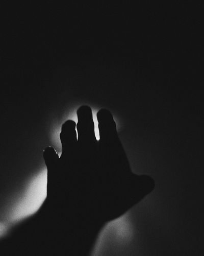 Silhouette person shadow on hand