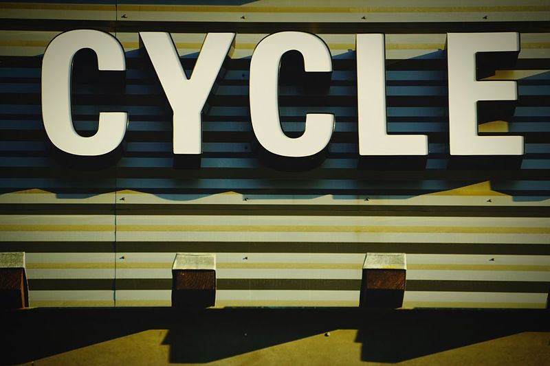 Something I miss doing. Photo taken at a place which empties my pockets Cycling Sign Signs Rei Shopping Sale Cycle
