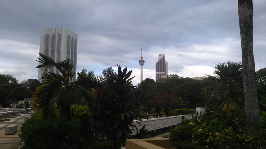 The beautiful kuala lampur, malaysia Malaysia Building Exterior High Angle View Tree Modern City Nature Outdoors Architecture Sky Sony Xperia Day Cloud - Sky Skyscraper Cityscape Travel Destinations Capture The Moment Welcome Weekly. Welcomeweekly EyeEmNewHere