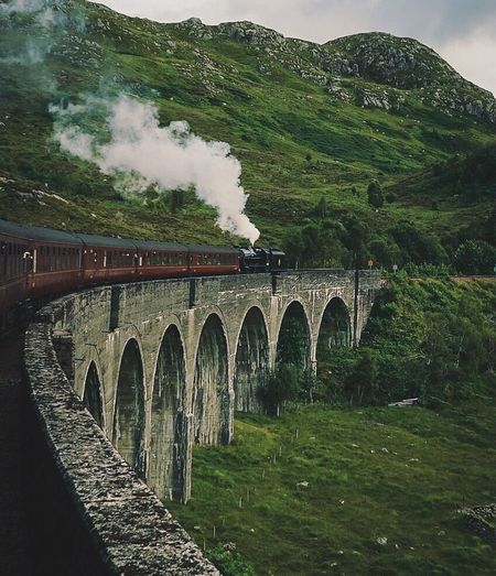 Jacobite steam train going over Glenfinnan Viaduct Glenfinnan Jacobite