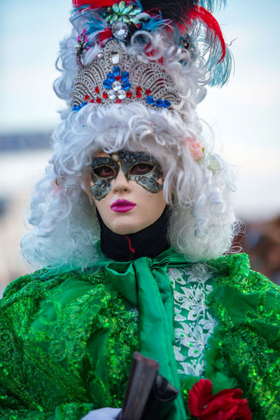 Carnival Carnival In Venice Venice, Italy Carnival Clothing Carnival Masks Celebration Childhood Close-up Costume Day Feather  Focus On Foreground Front View Green Color Headwear Leisure Activity Lifestyles Looking At Camera Multi Colored One Person Outdoors People Portrait Real People Sky Venetian Mask