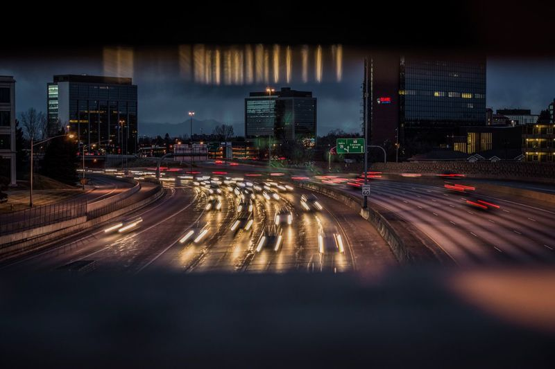 Evening Traffic Traffic Lights Interstate Denver Colorado  Illuminated Road Night Speed Transportation Light Trail Motion Architecture Long Exposure Building Exterior Traffic Built Structure City No People Blurred Motion Outdoors High Street Cityscape Sky Bridge View Reflection