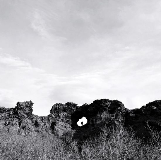 Black And White Friday Landscape Tranquility Nature Grass Outdoors Day Sky No People Beauty In Nature Scenics Adventure IPhoneography Iceland IPhone The Week On EyeEm Dimmuborgir Kirkjan Rock Formation Cave Perspectives On Nature hiding in Church The Mobile Photographer - 2019 EyeEm Awards