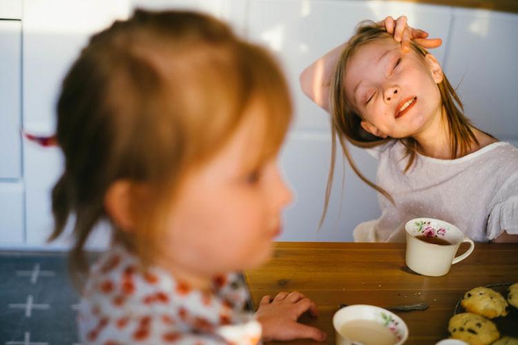 Portrait of cute girl having food