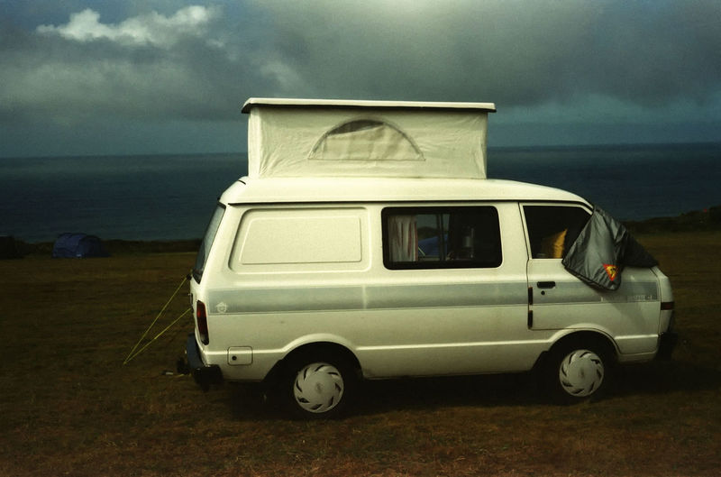 Camper at Bedruthan Steps. Shot on expired film. Minolta AL Atlantic Bedruthansteps Campervan Camping Close-up Cloud - Sky Coast Cornwall Day Expired Film Field Film Lomography Nature Nissan No People Ocean Outdoors Poptop Rain Sky Transportation Weather Wheelhome Camp