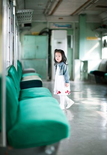 Portrait of girl on train carriage