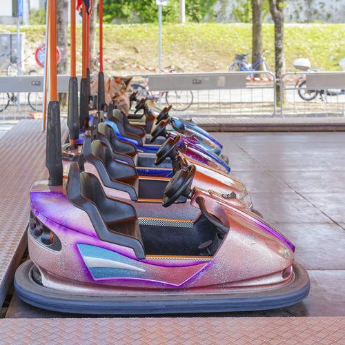 Bumper cars in row at amusement park