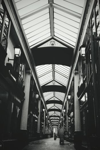 Shopping Arcade. Indoors  Architecture Built Structure No People City Arcade Built Environment Shopping Mall Shopping Shopping Arcade Classic Architecture Glamourous Independent Shop Retail  Retail Store Retail Experience Shopping Experience Shopping Centre Shopping Street Shopping Center Bristol Uk Uk Retail Broadmead Architecture_collection The Architect - 2017 EyeEm Awards EyeEmNewHere Black And White Friday