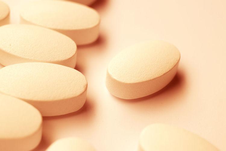 Close-up of medicines over orange background