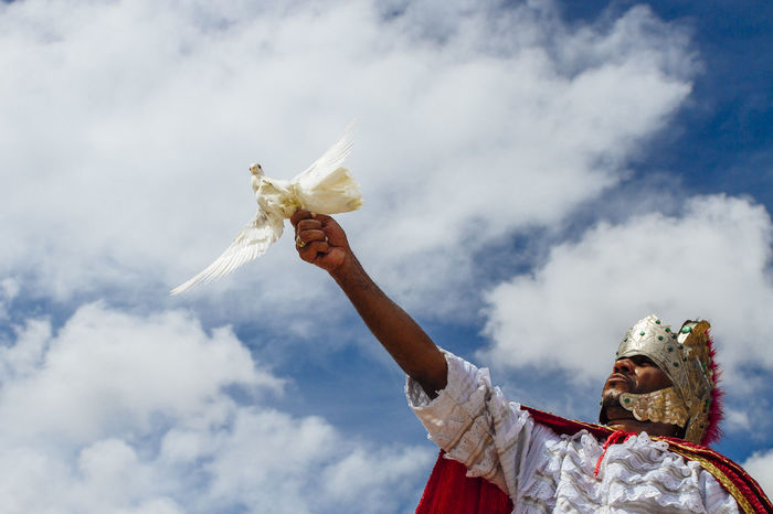 Priest offers white dove in honor of St. George and Yemenja AFRICAN CULTURE African Rituals Celebration Cloud - Sky Dove Holding Low Angle View Offerings To The Gods One Person Outdoors Religion Religion And Beliefs Religion And Tradition Sky Spirituality Street Photography Streetphotography The Street Photographer - 2017 EyeEm Awards White Dove