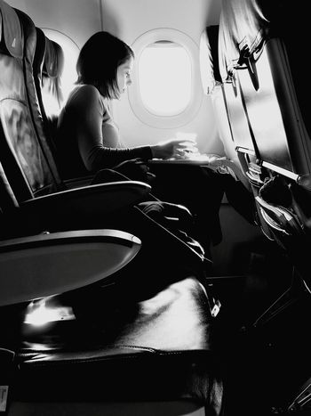 Transportation Vehicle Interior Mode Of Transport Adults Only Only Women Young Adult Travel Airplane Vehicle Seat Black And White Photography Blackandwhitephotography Blackandwhite Blackandwhite Photography