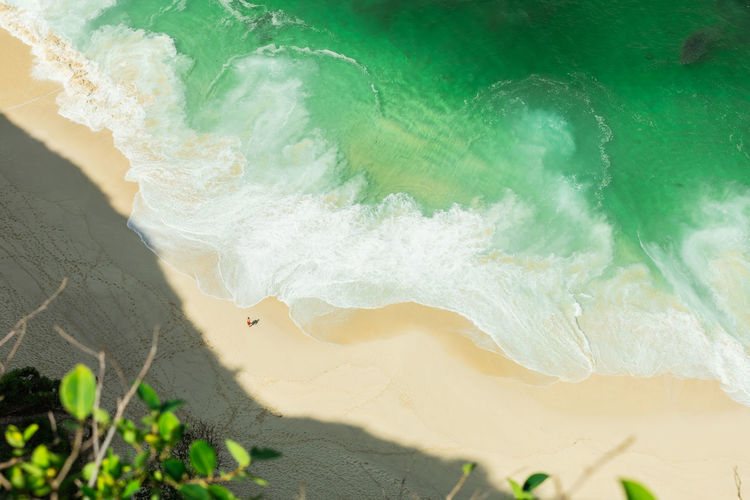 Aerial view of man standing on beach