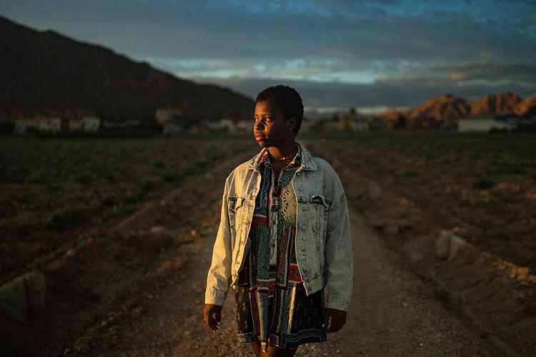 Portrait of teenage girl standing on land
