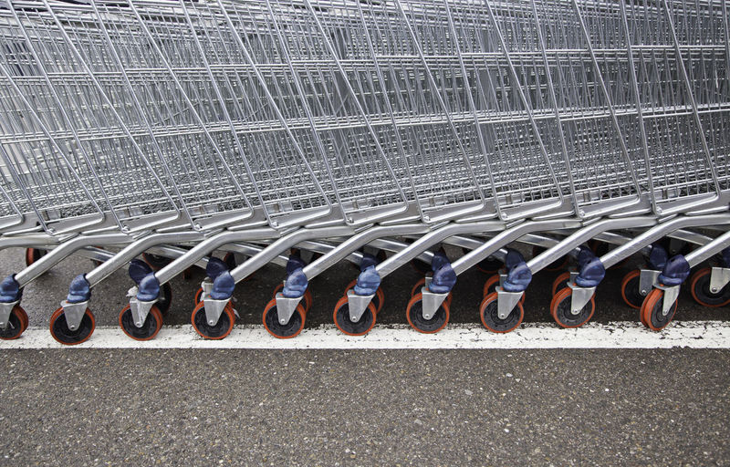 In A Row No People Side By Side Metal Large Group Of Objects Close-up Shopping Cart Order Wall - Building Feature Hanging Retail  Day Shopping Rack Repetition Connection Gray Arrangement Choice Pattern