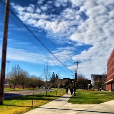 Sunny Corvallis Oregon Oregonstateuniversity osu clouds cloudgramin people walking sidewalk