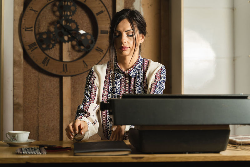 Woman working on table at home