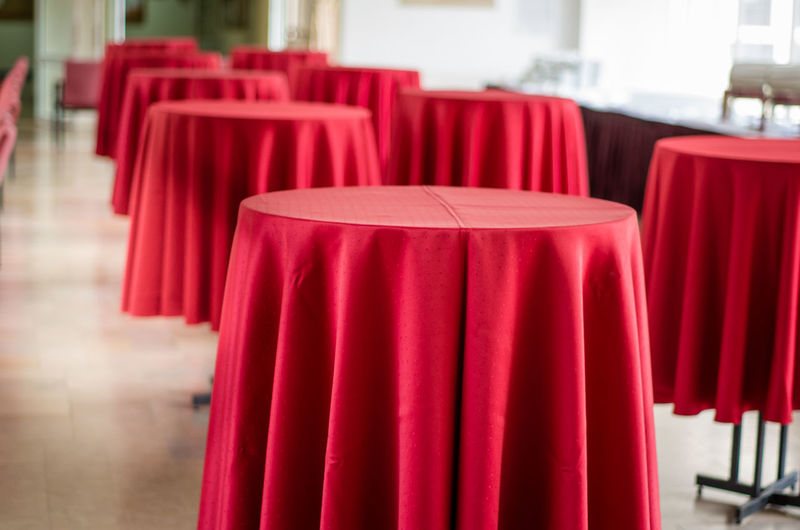 Absence Arrangement Arts Culture And Entertainment Chair Close-up Day Empty Focus On Foreground In A Row Indoors  Large Group Of Objects Luxury No People Red Restaurant Setting Table Textile Vibrant Color