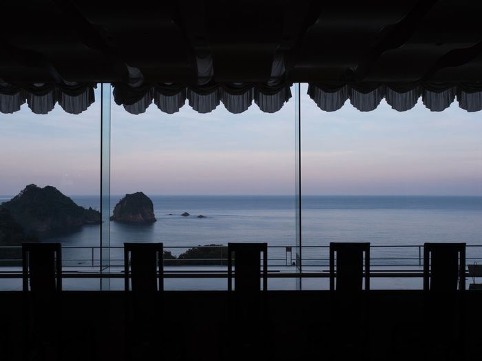 Quiet dawn. Simple Quiet Love Japan Shizuoka M.ZUIKO DIGITAL Lumix G9 View Scenics Chair Sky Sea Tranquil Scene Tranquility No People Silhouette Dawn Horizon Over Water Beauty In Nature Nature Water The Traveler - 2018 EyeEm Awards Architecture