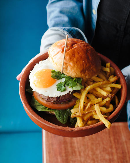 not healthy eating Egg Yolk Fried Egg Blue Burger Close-up Day Egg Food Food And Drink French Fries Freshness Hamburger Indoors  Indulgence One Person Plate Ready-to-eat Table Unhealthy Eating