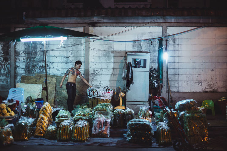 Man on a night market Night Lights Night Photography Butcher Freshness Full Length Illuminated Market Stall Marketplace Men Neon Neon Life Neon Lights Night Night Market Night Market In Thailand Occupation One Person Real People Retail  Standing Young Adult