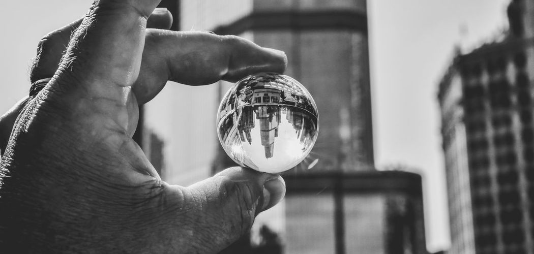 EyeEm Selects city skyscraper seen through Crystal Ball Human Body Part Close-up Architecture Human Hand Urban Skyline Prism Crystal Ball Sphere Fortune Telling Skyscraper Ball Orb Crystal Connection Copy Space Bradley Olson Bradleywarren Photography Urban Geometry Photography Props Architecture City Building Exterior Urban Landscape Globe