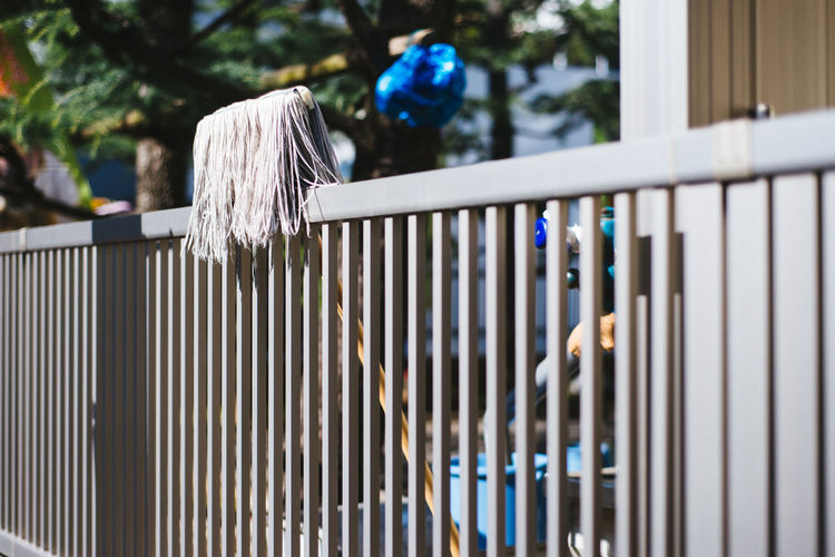 Mop on fence
